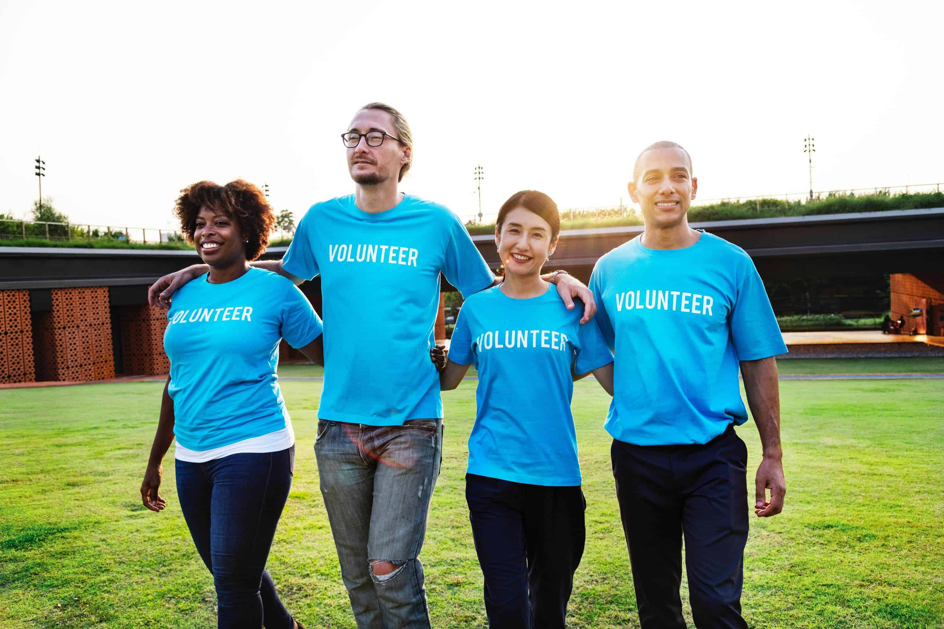 Image of four volunteers - volunteerism