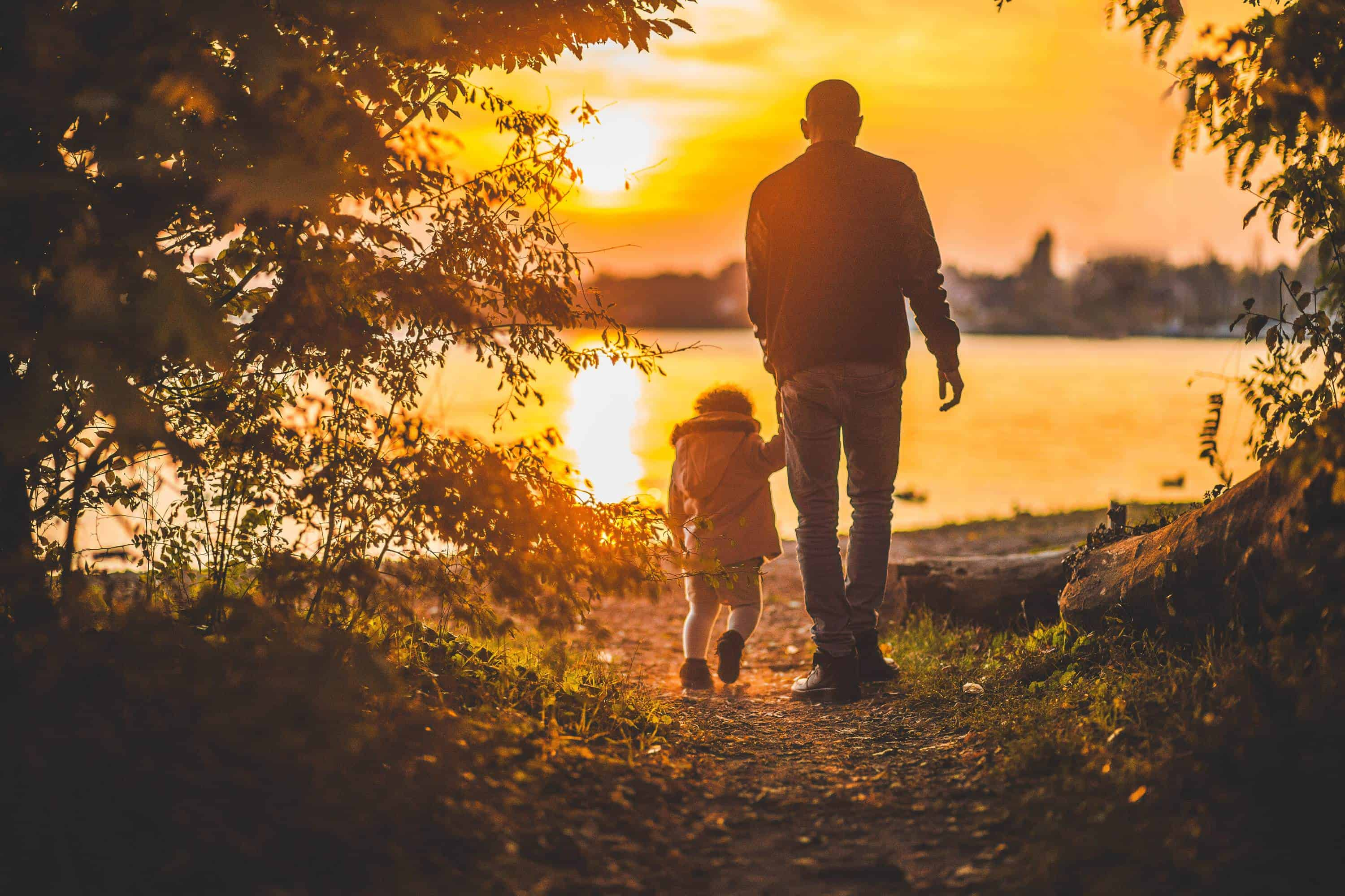 Father's Day Image - man with child at sunset